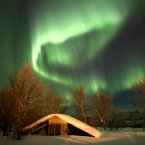 The Northern Lights are visible at Porsanger Garrison, as troops take part in Exercise Hairspring 2013, which focuses on cold weather survival and warfare training for Royal Marines Commando Reservists in the mountains range near to Porsanger Garrison near Lakselv, Norway.