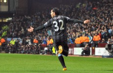 Clark punished as Tevez keeps City's title hopes alive