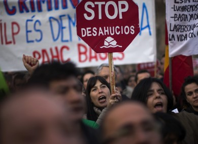 Protesters hold banners against evictions as they march along a street during a demonstration in Barcelona, Spain.