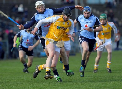 Antrim's Stephen Beatty with Dublin's Liam Rushe.