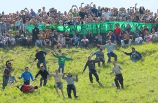 Photos: One winner, many losers at annual cheese rolling race